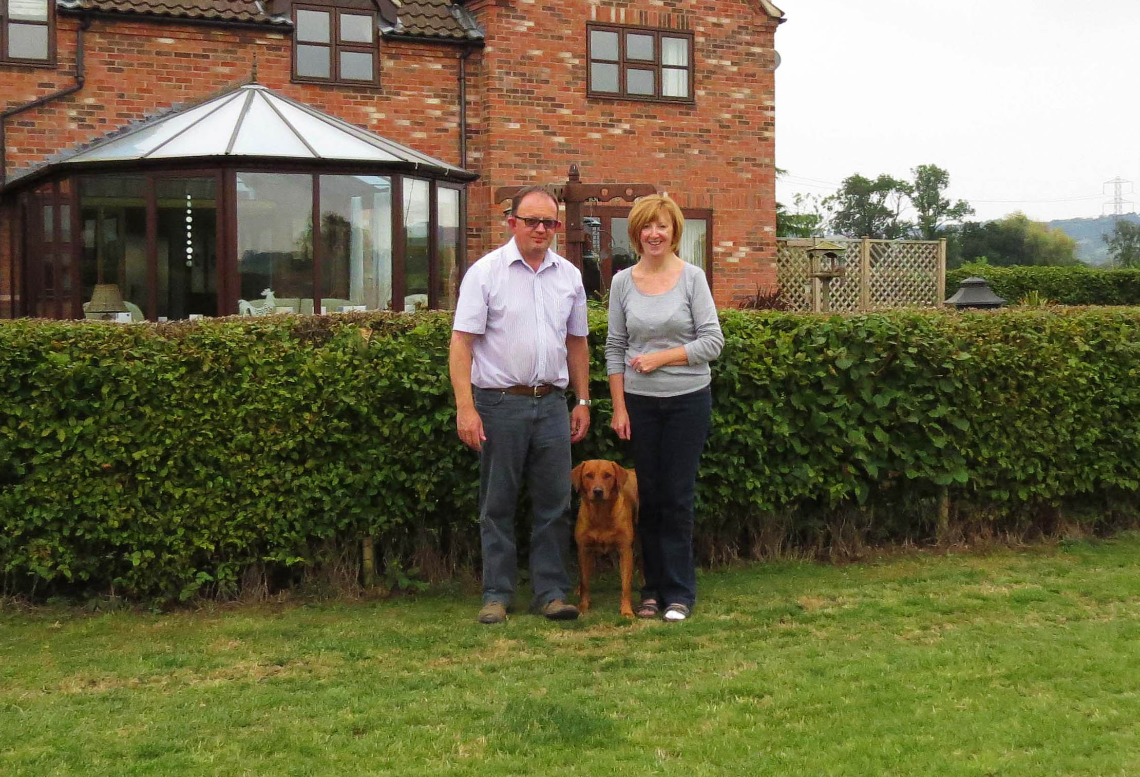 Andy Wiles, Hilary Wiles and Bracken the dog.